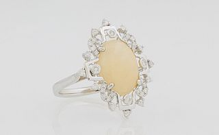 Lady's 14K White Gold Dinner Ring, with a 3.4 carat oval cabochon opal, within a border of round diamonds, total diamond weight- .37...