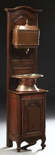 French Provincial Louis XV Style Copper and Brass Lavabo, early 20th c., the copper reservoir and basin on an arched carved walnut f...