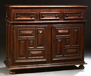 French Provincial Louis XIII Style Carved Walnut Sideboard, 19th c., the stepped top over three frieze drawers, above large cupboard...