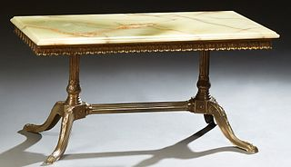 French Louis XV Style Brass and Onyx Coffee Table, 20th c., the ogee edge figured onyx top over a scalloped leaf skirt, on turned ta...