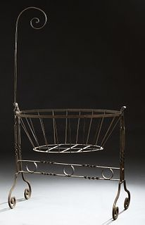 French Wrought Iron Cradle, 19th c., with a mosquito netting hook on one end, with canted rod sides, H.- 71 in., W.- 42 in., D.- 22...