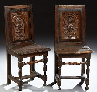 Pair of Louis XIII Style Carved Oak Side Chairs, c.1820, Brittany, each with a carved rectangular back with a profile of a man and w...