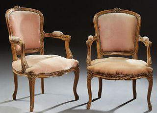 Pair of French Louis XV Style Upholstered Beech Fauteuils, 20th c., the floral carved crest above an upholstered shield shaped back,...