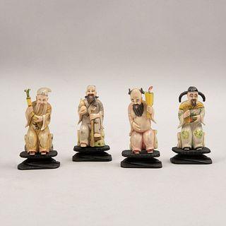 Lote de personajes orientales. China. Siglo XX. Elaborados en marfil policromado. Con bases de madera. 8 cm de alto. Pzs: 4.