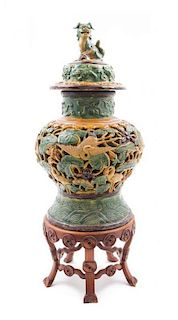 * A Sancai Glazed Pottery Jar and Cover Height of jar 19 inches.
