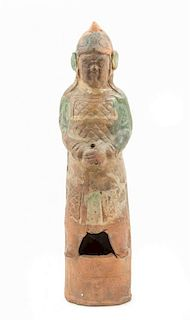 * A Sancai Glazed Pottery Figure of an Attendant Height 21 x width 5 1/2 inches.
