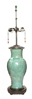 A Chinese Celadon Glazed Porcelain Vase Height 30 1/4 inches.