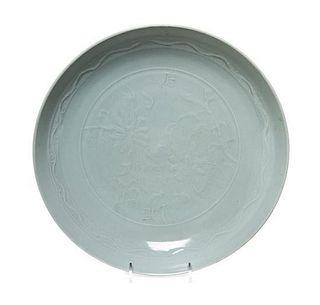 * A Celadon Glazed Porcelain Shallow Dish Diameter 11 inches.