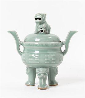 A Celadon Glazed Porcelain Tripod Censer Height 9 inches.