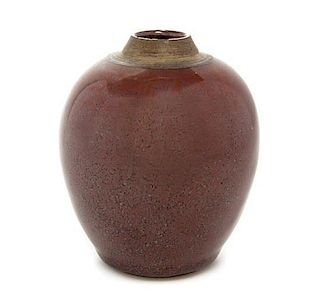 * A Red Glazed Pottery Jar Height 4 1/8 inches.