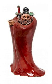 A Polychrome Enameled Porcelain Figure of an Immortal Height overall 17 inches.