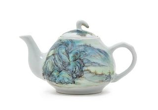 A Polychrome Enameled Porcelain Teapot Height 3 1/2 inches.