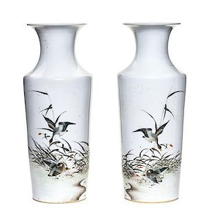 A Pair of Polychrome Enameled Porcelain Vases Height of pair 10 1/2 inches.