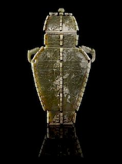 * An Archaistic Jade Vessel and Cover Height 11 x width 8 inches.