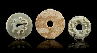 * A Group of Seven Carved Jade Bi Discs Diameter of largest 9 inches.