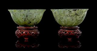 * A Pair of Spinach Jade Bowls Diameter 4 1/8 inches.
