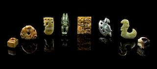 * A Group of Eight Jade Carvings Length of longest 2 3/4 inches.