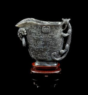 * A Large Carved Jade Libation Cup Height of jade 8 5/8 inches.