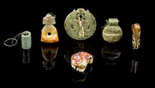 * A Group of Six Jade Carvings Diameter of largest 3 1/4 inches.