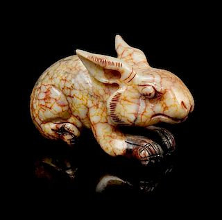 * A Jade Carving of a Rabbit Width 6 1/2 inches.