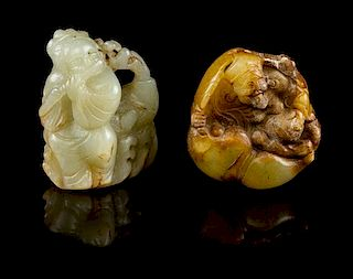 * Two Carved Jade Figural Toggles Height of first 2 1/4 inches.