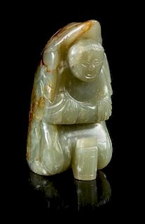 * A Carved Jade Figural Toggle Height 2 1/8 inches.