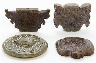 * A Group of Three Carved Jade Toggles Width of widest 2 5/8 inches.