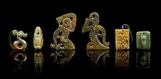 * A Group of Six Jade Carvings Height of tallest 4 inches.