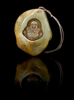 * A Carved Jade Pebble Length 2 3/8 inches.