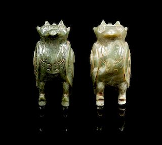 * A Near Pair of Carved Jade Figures of Owls Height of pair 4 inches.