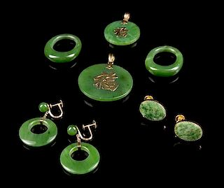 A Group of Chinese Spinach Jade Articles Diameter of largest 1 3/8 inches.