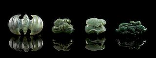 * A Group of Four Spinach Jade Pendants Length of largest 2 1/2 inches.