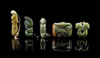 * A Group of Six Jade Carvings Height of tallest 5 3/8 inches.