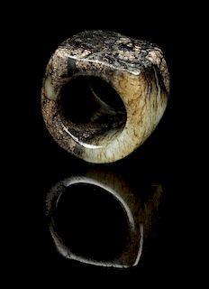 * A Jade Archer's Ring Diameter 1 3/8 inches.