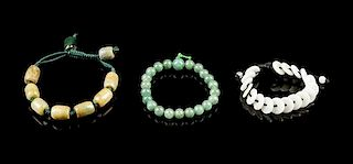 A Group of Three Chinese Jadeite Beaded Bracelets Diameter of largest 2 3/4 inches.