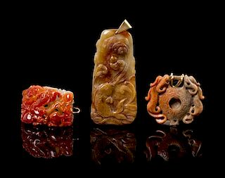 A Group of Three Carved Hardstone Pendants Height of largest 3 1/4 inches.