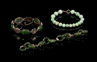 A Group of Three Hardstone Bracelets Length of longest 6 inches.