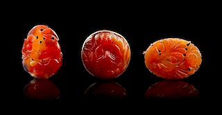 * A Group of Three Carved Carnelian Articles Height of largest 2 inches.