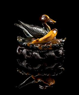* A Carved Tiger's Eye Figural Group Length 5 inches.