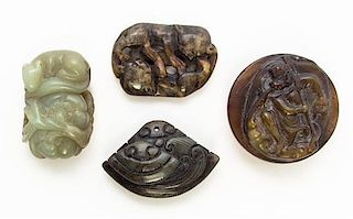 * A Group of Four Hardstone Carvings Diameter of buckle 2 1/8 inches.