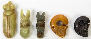 * A Group of Five Carved Hardstone Toggles Height of tallest 3 1/2 inches.