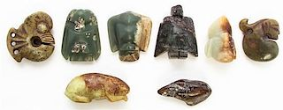 * A Group of Eight Carved Hardstone Toggles Length of longest 2 5/8 inches.