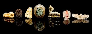 * Seven Carved Hardstone Toggles Height of largest 1 3/4 x width 2 1/4 x length 3 1/4 inches.