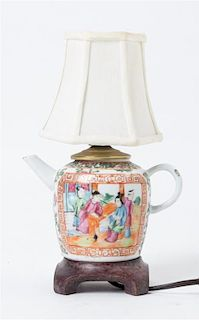 A Rose Medallion Porcelain Teapot Height 8 3/8 inches.