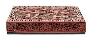 A Cinnabar Lacquered Box and Cover Height 2 1/2 x width 15 x depth 11 inches.
