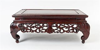 A Carved Rosewood Stand Height 7 1/4 x width 18 x depth 11 inches.