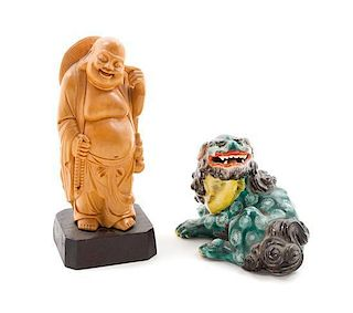 * A Carved Wood Figure of Budai Height of largest 4 x length 6 inches.