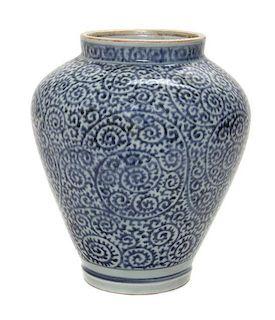 * A Japanese Arita Karakusa Jar Height 9 1/2 inches.