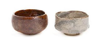 * Two Japanese Pottery Bowls Diameter of largest 4 1/2 inches.