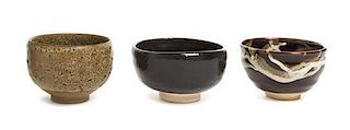 * Three Japanese Pottery Bowls Height of largest 3 1/2 x diameter 4 3/4 inches.